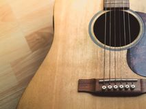 Acoustic Guitar. On Wooden Background with Copy Space Stock Image