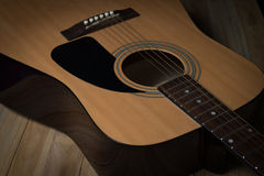Acoustic guitar on wooden background Royalty Free Stock Photography
