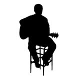 Acoustic Guitarist. Silhouette of person playing guitar Stock Images