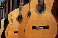 Acoustic guitars. Close-up of acoustic guitars in a music shop stock photo