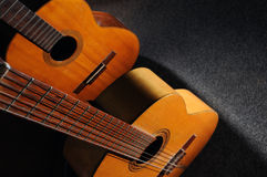 Acoustic guitars. Detail of two old wooden acoustic guitars - still life Royalty Free Stock Photos