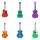 Acoustic guitars on colored background Stock Photos