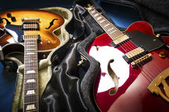 Acoustic guitars in covers. In a blue background Stock Images