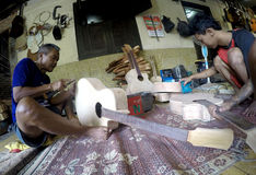 Acoustic guitars. Craftsmen create acoustic guitars in Solo, Central Java, Indonesia Stock Photo