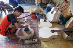Acoustic guitars. Craftsmen create acoustic guitars in Solo, Central Java, Indonesia Stock Image