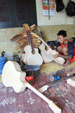 Acoustic guitars. Craftsmen create acoustic guitars in Solo, Central Java, Indonesia Royalty Free Stock Photo