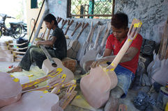 Acoustic guitars. Craftsmen are making acoustic guitars in Sukoharjo, Central Java, Indonesia Stock Photography