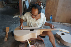 Acoustic guitars. Craftsmen are making acoustic guitars in Sukoharjo, Central Java, Indonesia Royalty Free Stock Photo