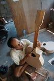 Acoustic guitars. Craftsmen are making acoustic guitars in Sukoharjo, Central Java, Indonesia Stock Photo