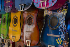 Acoustic Guitars on display. Multiple Colorful Acoustic Guitars on Display Stock Images