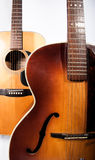 Acoustic guitars. Two classic acoustic guitars standing one in front of the other Stock Photography