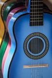 Acoustic Guitarson Display. Colored acoustic guitars on display by street vendor Stock Images