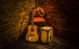 Acoustic instruments. On small stage in bar stock images