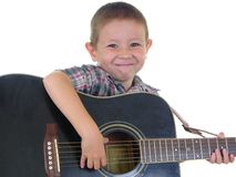Acoustic Man. Boy playing an acoustic guitar Stock Images
