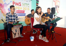 Acoustic music. Students are being staged acoustic music at a shopping center in Sukoharjo, Central Java, Indonesia stock photos