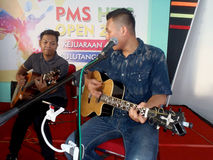 Acoustic music. Students are being staged acoustic music at a shopping center in Sukoharjo, Central Java, Indonesia royalty free stock images