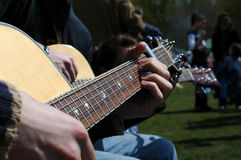 Acoustic Musicians. Close-up of acoustic guitars and musicians hands Stock Images