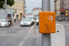 Acoustic signal system for blind people on a zebra crossing. An orange acoustic signal system for blind people on a zebra crossing Royalty Free Stock Photo