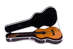 Acoustic spanish guitar in case. On white backround, classical musical instrumet Stock Photo