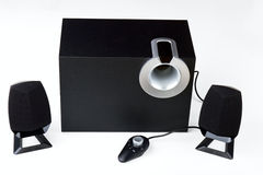 Acoustic system. With wire remote control on a white background Royalty Free Stock Photo