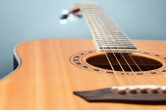 Acoustic wooden guitar. Close-up of guitar lying on cold backgro Royalty Free Stock Photos