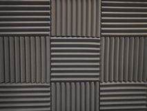 Acoustical foam or tiles for sound dampening. Music room. Soundproof room. Low key photo. Stock Photography
