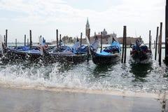 Acqua alta floods gondola parking in Venice, Italy Royalty Free Stock Image