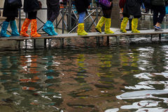 Acqua Alta, Venice. Boots and other footwear used in High water (Acqua Alta) in Venice, Veneto, Italy Royalty Free Stock Photo
