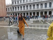 Acqua alta in Venice. VENICE, ITALY - CIRCA MARCH 2018: Acqua alta meaning high water in St Mark square Royalty Free Stock Photography
