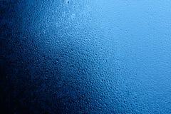 Acqua blu sulla finestra Fotografia Stock