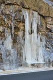 Acqua congelata sopra la strada Immagine Stock
