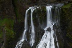 Acqua di caduta a Fagrifoos (bella cascata), Islanda del sud Immagine Stock Libera da Diritti