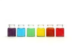 Acqua di colori in bottiglie Fotografia Stock