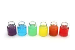 Acqua di colori in bottiglie Fotografia Stock Libera da Diritti