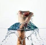 Acqua di perforazione del pugno Fotografie Stock Libere da Diritti