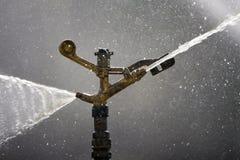 Acqua di spruzzatura dello spruzzatore Immagine Stock Libera da Diritti