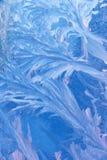 Acqua di vetro dei fiocchi di neve congelata Fotografie Stock