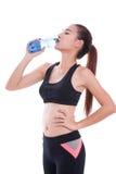 Acqua potabile della bella donna di forma fisica Fotografia Stock