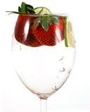 Acqua in un vetro con le righe Fotografia Stock