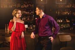 Acquaintance in bar, woman flirts with man Stock Photos