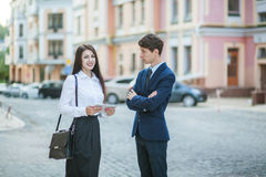 Acquaintance and communication of businessman, businesswoman Stock Photos