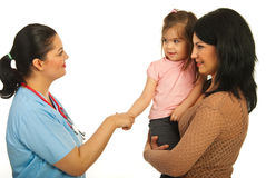 Acquaintance doctor with toddler girl Royalty Free Stock Images