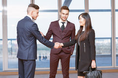 Acquaintance with a new co-worker. Acquaintance. Handsome businessman introducing the new colleague to his co-worker stock photography