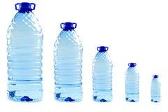 Acque in bottiglia isolate sul bianco Fotografia Stock