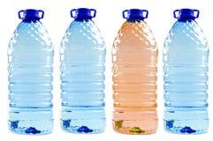 Acque in bottiglia isolate sul bianco Immagine Stock Libera da Diritti