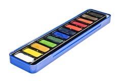 Acquerello in scatola blu su bianco Fotografia Stock
