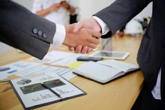 Acquisition business people shaking hands, finishing up a meeting. stock photo
