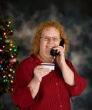 Acquistando dal telefono Fotografia Stock Libera da Diritti