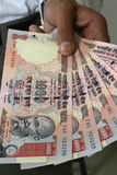 Acquisto con la valuta indiana Immagine Stock