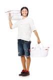 Acquisto dell'uomo con il carretto del canestro del supermercato Fotografie Stock